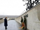 At ceremony in Dachau in presence of Holocasut survivors, German Chancellor Merkel 'greatly moved'