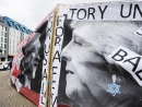 Labour supporters removed anti-Semitic banners showing Theresa May wearing a Star of David