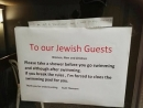 Swiss hotelier sorry for signs telling Jews to shower before entering pool