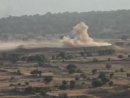 Israel strikes Syrian position after shells fall in Golan Heights