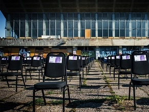 Chairs with fake money placed atop former Jewish cemetery in Lithuania